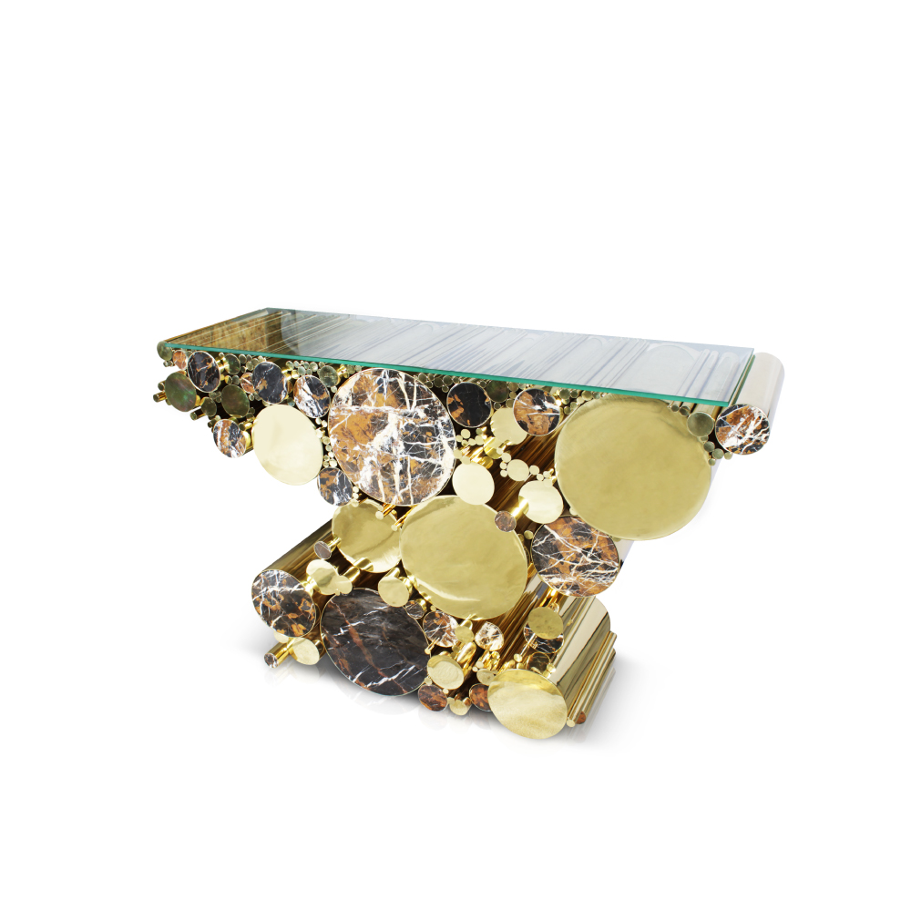Wanderlust Console, with black and gold marble, has a diversity of polished brass pipes with different thicknesses