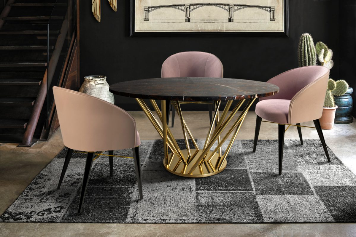 Nebula Dining Table is made of polished black and gold marble on a gold polished brass structure