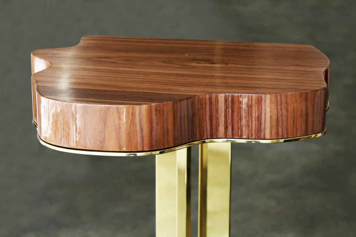 Marina Contemporary Bar Table features a walnut wood top, supported by a golden plated brass leg and base