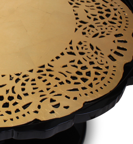 Crochet Center Table has a hand-carved wood top, coated in gold leaf