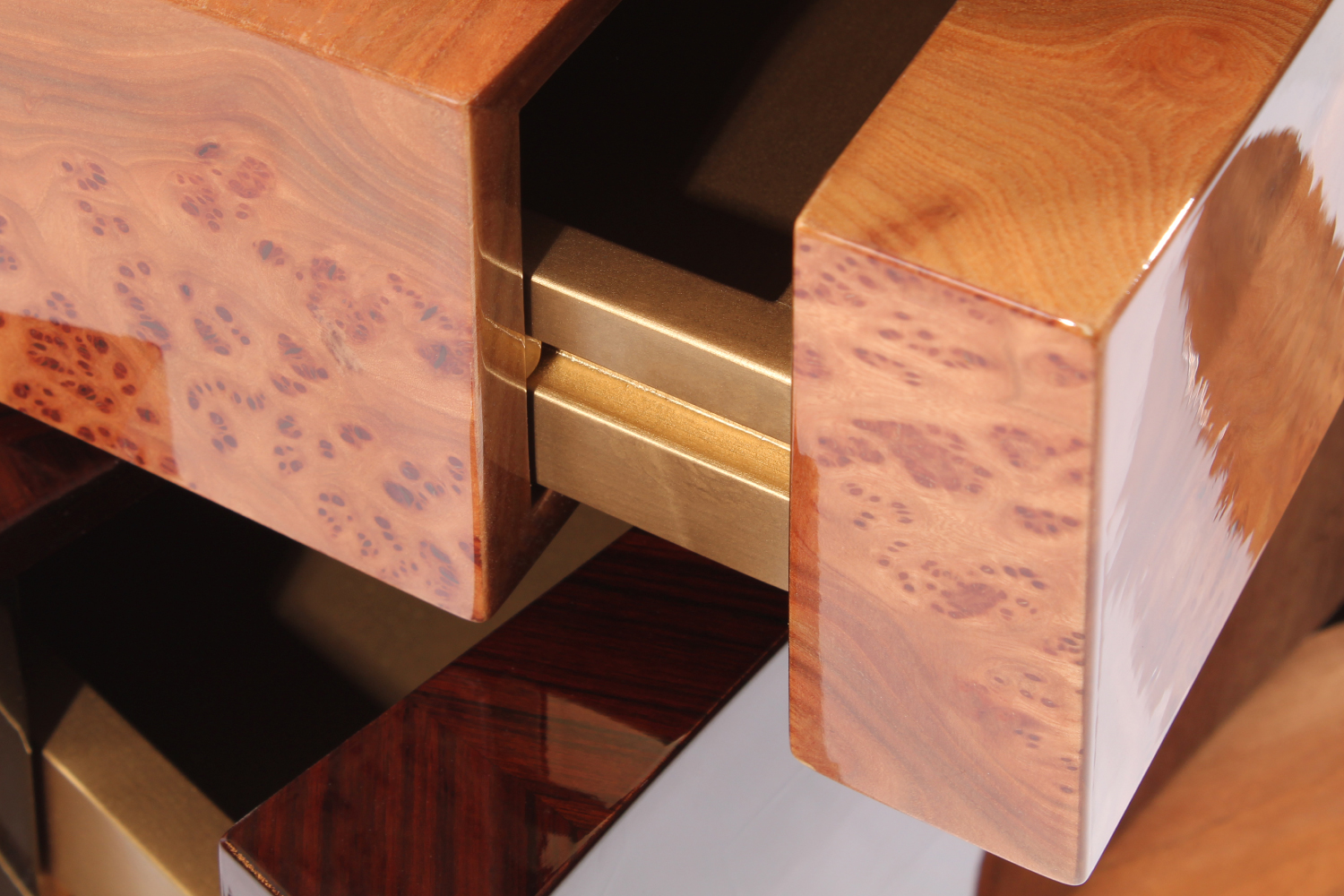 Hollow Swivel Chest of Drawers is structure in wood veneered with bird's eye, elm burl, ironwood and american walnut