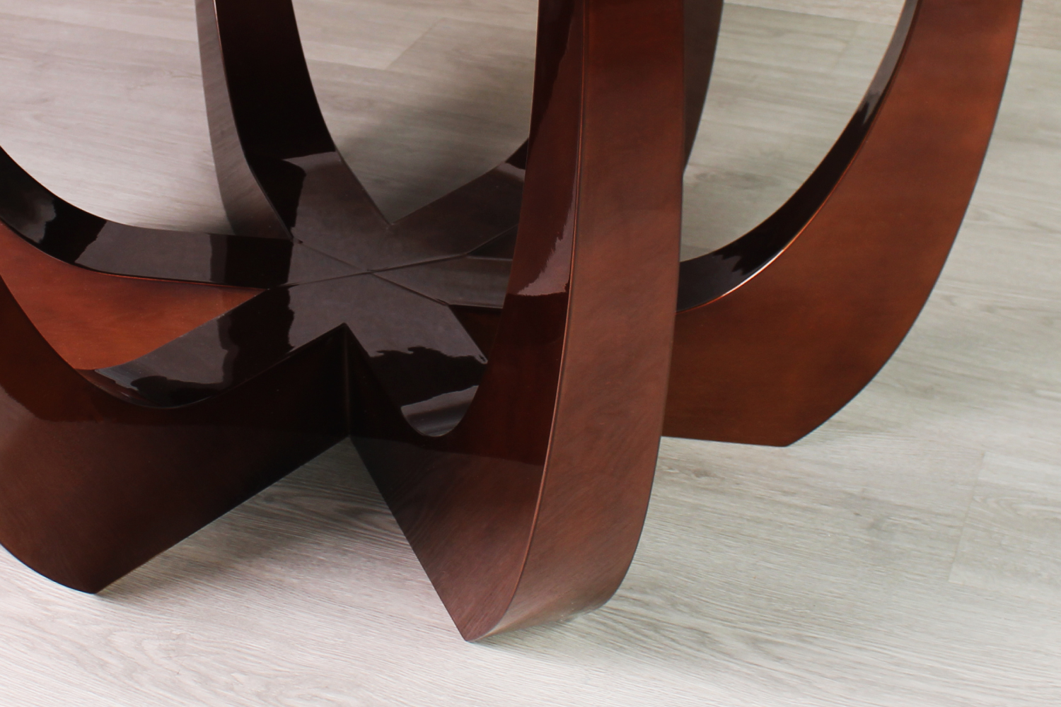 Canopy contemporary dining table in wood veneered with radial matched ironwood leaves