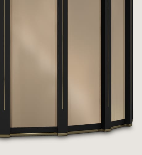 Elise Side Table has an opulent black lacquer body, ornamented with polished brass and bronze mirror,